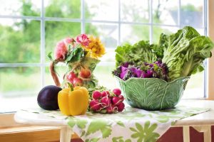 Fresh vegetables in a bright kitchen window
